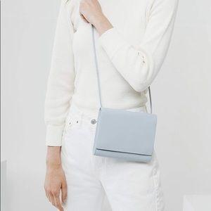 baggu powder blue compact purse